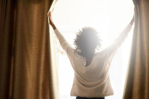 White, Curtain, Light, Window treatment, Backlighting, Yellow, Interior design, Sunlight, Shoulder, Lighting,