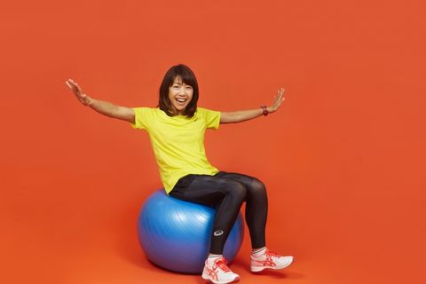Swiss ball, Ball, Arm, Shoulder, Yellow, Sitting, Joint, Leg, Exercise equipment, Physical fitness,