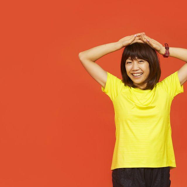 Yellow, Orange, Shoulder, Arm, T-shirt, Standing, Neck, Joint, Gesture, Human body,
