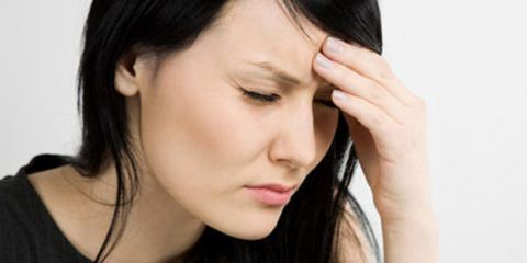 stressed woman with a headache