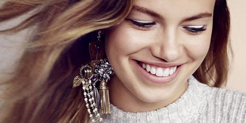 Lip, Smile, Hairstyle, Eyebrow, Earrings, Eyelash, Style, Tooth, Fashion accessory, Sweater,
