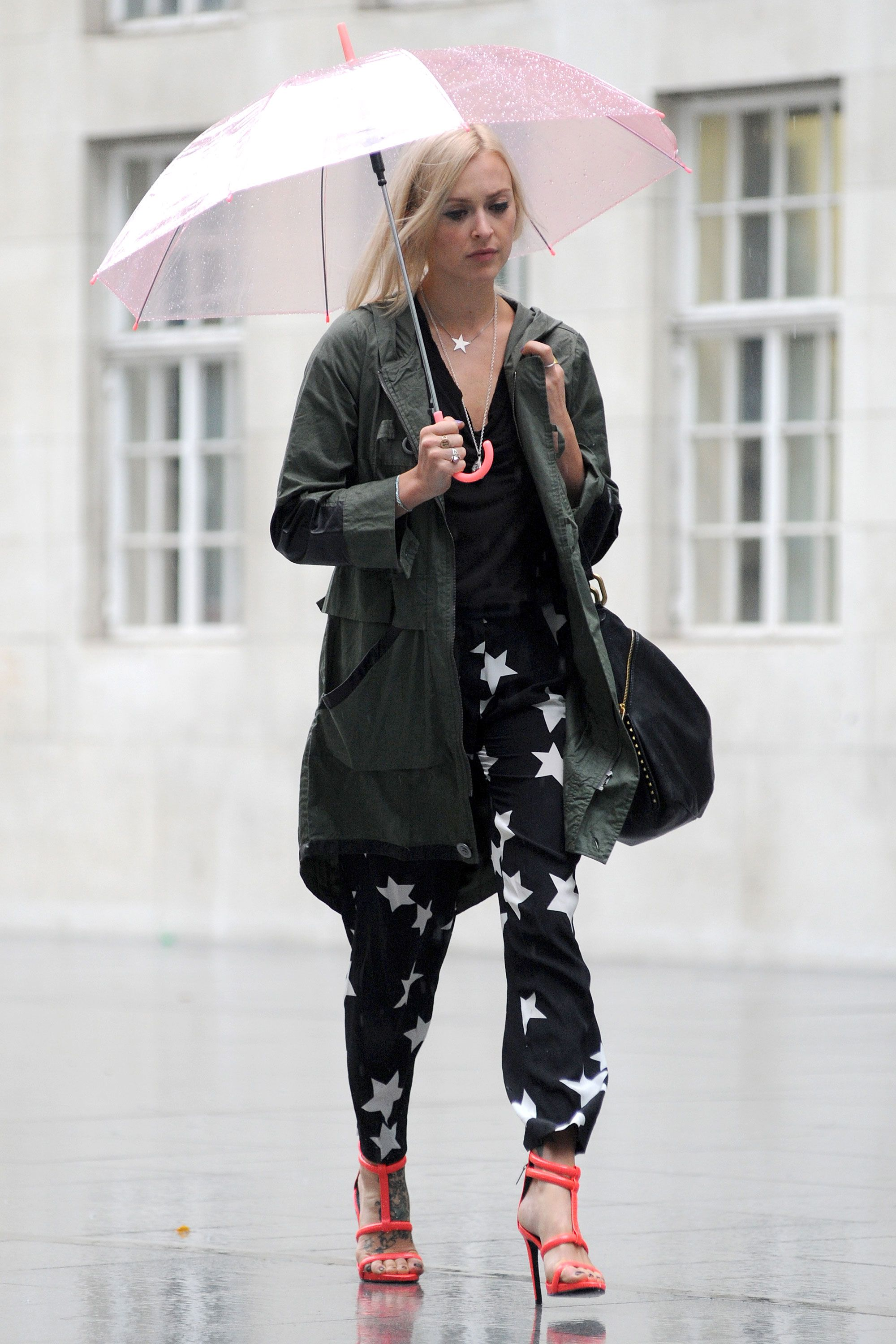 Rain on Cotton's parade? Never. She's all business up top in a windbreaker, but party on the bottom in strappy heels.
