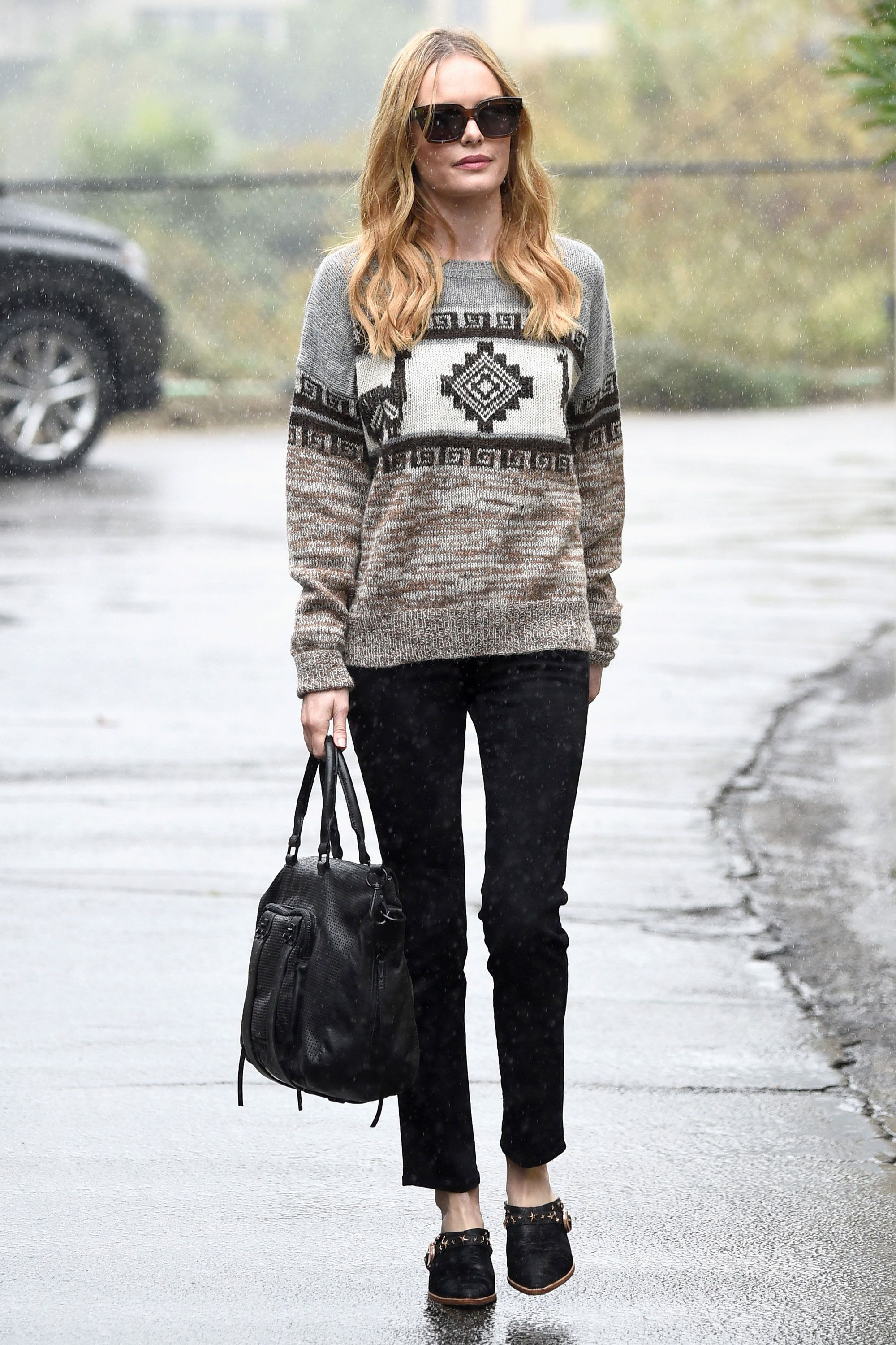 How does one accessorize with snow flurries? Take a cue from Bosworth and thrown on a toasty knit.