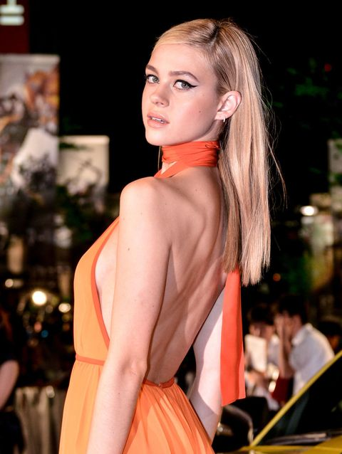 Lip, Hairstyle, Earrings, Shoulder, Eyelash, Style, Fashion show, Orange, Fashion model, Dress,