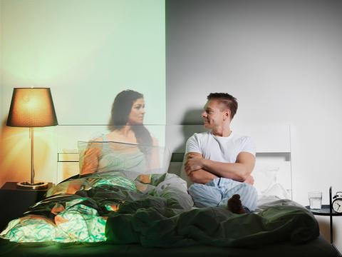 Room, Lighting, Comfort, Human body, Lamp, Lampshade, Sitting, Bed, Bedroom, Linens,