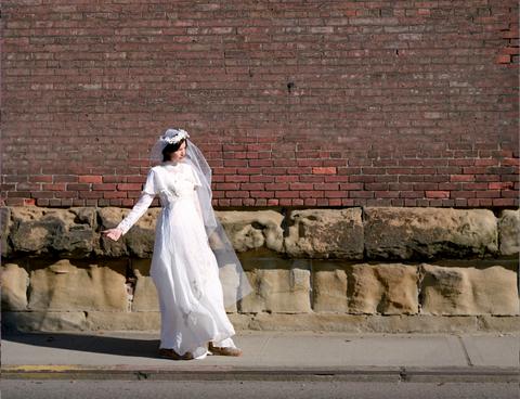 Dress, Brick, Photograph, Wall, Bridal clothing, Wedding dress, Bride, Gown, Brickwork, Bridal veil,