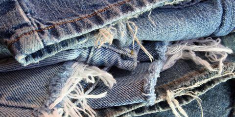 Denim, Textile, Close-up, Thread, Wool, Fiber, Natural material, Stitch, Knot, Woven fabric,