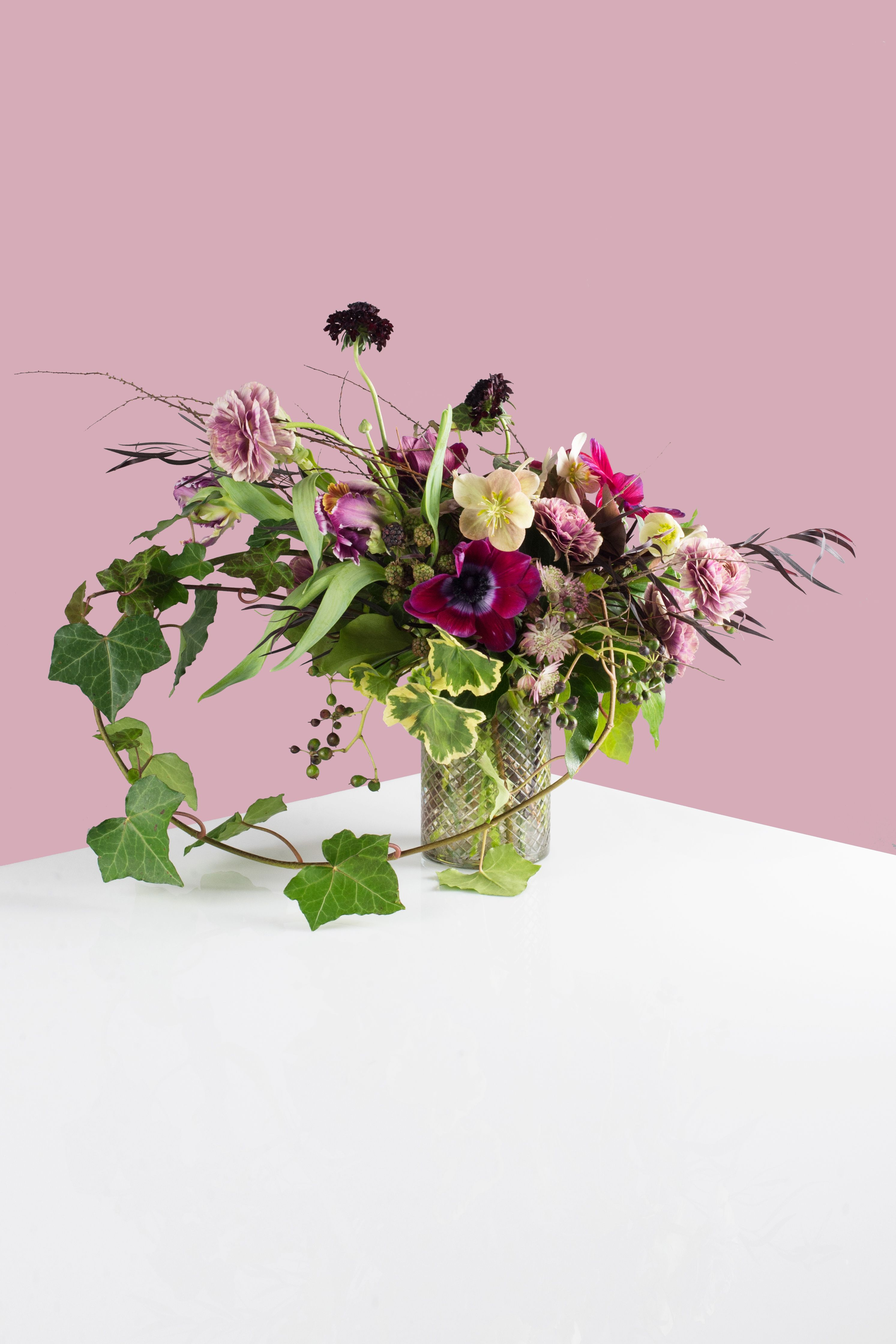 <p>For this girl, you should go for deep plum tones, twisted together. This arrangement is a gathering of the most hauntingly beautiful blooms,a little witchy and wild.</p> <p><em>Materials: Parrot Tulip, Ranunculus, Hellebores, Tetra Anemone, Astrantia, Agonis, Geranium, Spirea, Blackberries, Ivy</em></p> <p><em>Retails at $200.</em></p>