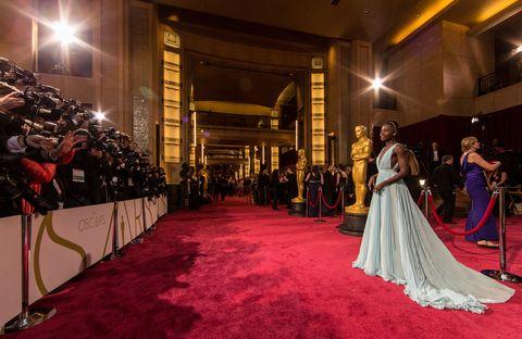 Lighting, Dress, Flooring, Suit, Carpet, Formal wear, Gown, Petal, Bridal clothing, Hall,