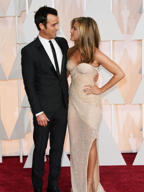 HOLLYWOOD, CA - FEBRUARY 22:  Actors Justin Theroux (L) and Jennifer Aniston attend the 87th Annual Academy Awards at Hollywood & Highland Center on February 22, 2015 in Hollywood, California.  (Photo by Jason Merritt/Getty Images)