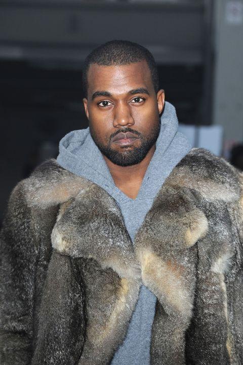 Textile, Facial hair, Fur clothing, Street fashion, Black hair, Fur, Buzz cut, Fashion show, Natural material, Crew cut,