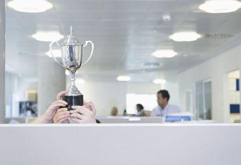Trophy, Ceiling, Award, Electricity, Light fixture, Ceiling fixture, Transparent material, Fluorescent lamp, Science,