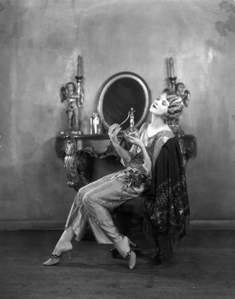 1st October 1925:  Actress Thalia Barbarova applying perfume at her dressing table.  (Photo by Sasha/Getty Images)
