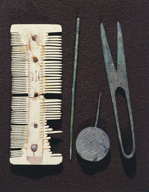 FRANCE - CIRCA 2002:  Personal utensils: bone comb, scissors, hair pin. Merovingian civilization, 5th-8th century. (Photo by DeAgostini/Getty Images)