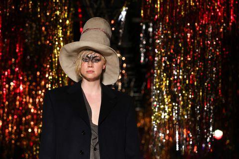 Hat, Coat, Outerwear, Suit, Blazer, Costume accessory, Headgear, Fashion accessory, Costume hat, Sun hat,