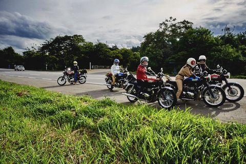 Motorcycle, Tire, Motorcycle helmet, Motorcycling, Fender, Automotive tire, Helmet, Automotive lighting, Fuel tank, Motorcycle accessories,