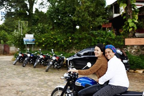 Motorcycle, Land vehicle, Fender, Automotive lighting, Automotive tire, Motorcycle accessories, Auto part, Motorcycle helmet, Fuel tank, Automotive mirror,