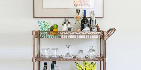 Green, Bottle, Glass, Glass bottle, Shelving, Drink, Drinkware, Dishware, Alcoholic beverage, Serveware,