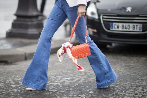 Blue, Vehicle registration plate, Automotive design, Denim, Textile, Jeans, Bag, Automotive exterior, Headlamp, Street fashion,
