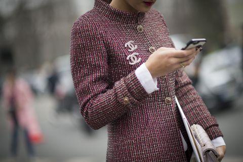 Sleeve, Hand, Pattern, Street fashion, Technology, Mobile phone, Plaid, Gadget, Portable communications device, Communication Device,