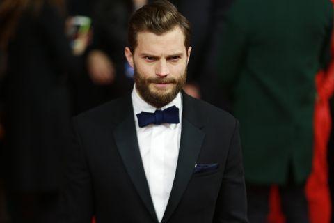 Ear, Coat, Collar, Dress shirt, Shirt, Facial hair, Suit, Outerwear, Formal wear, Bow tie,