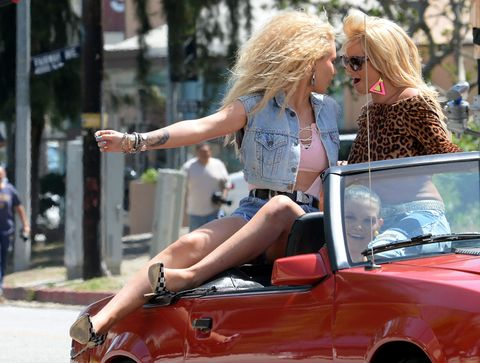 Eyewear, Vision care, Sunglasses, Hood, Street fashion, Convertible, Roadster, Blond, Vehicle door, Windshield,