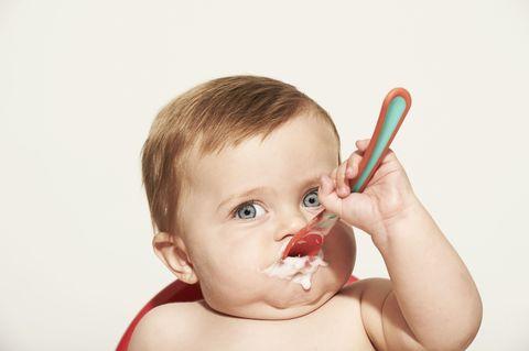 Finger, Child, Neck, Taste, Kitchen utensil, Toddler, Eyelash, Spoon, Nail, Baby,