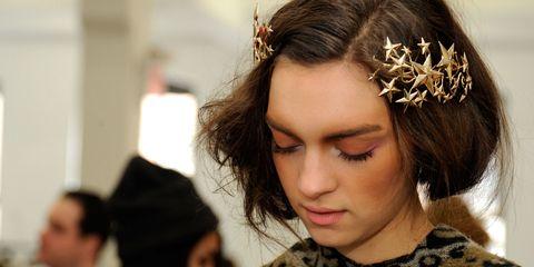 Ear, Mouth, Hairstyle, Eyebrow, Eyelash, Style, Headpiece, Hair accessory, Fashion, Black hair,
