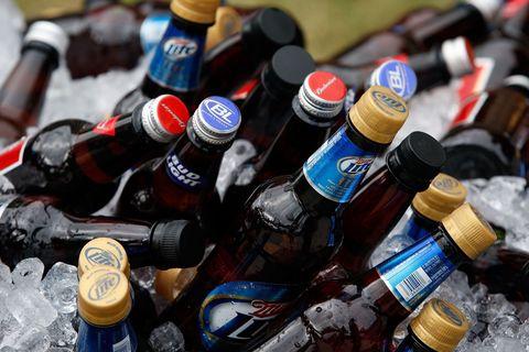 Bottle, Alcohol, Bottle cap, Drink, Alcoholic beverage, Glass bottle, Drinkware, Collection, Label, Beer bottle,