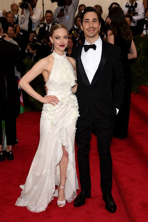 """NEW YORK, NY - MAY 04:  Amanda Seyfried (L) and Justin Long attend the """"China: Through The Looking Glass"""" Costume Institute Benefit Gala at the Metropolitan Museum of Art on May 4, 2015 in New York City.  (Photo by Dimitrios Kambouris/Getty Images)"""