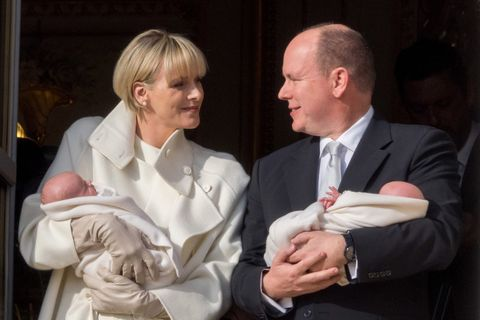 MONACO - JANUARY 07: Prince Albert II of Monaco and Princess Charlene of Monaco pose with Prince Jacques and Princess Gabriella on the Balcony of the Monaco Palace during the official presentation of the Monaco Twins on January 7, 2015 in Monaco, Monaco.  (Photo by Didier Baverel/WireImage)