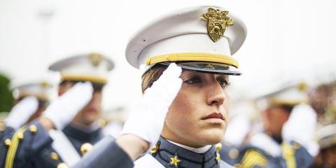 Uniform, Military person, Headgear, Collar, Costume accessory, Peaked cap, Gesture, Law enforcement, Military, Official,