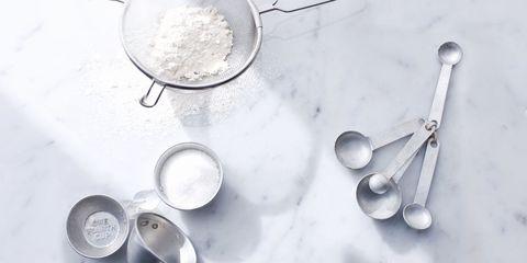 Ingredient, Flour, Powder, Chemical compound, Metal, Circle, Kitchen utensil, Silver, All-purpose flour, Bread flour,