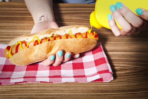 Finger, Yellow, Food, Finger food, Cuisine, Baked goods, Nail, Hot dog bun, Snack, Fast food,