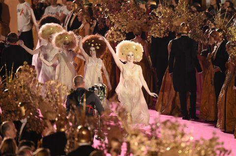 Dress, Tradition, Ceremony, Party, Toy, Cut flowers, Flower Arranging, Decoration, Floral design, Embellishment,