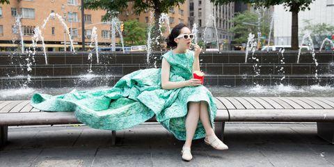 Green, Fountain, Dress, Sitting, Sunglasses, Teal, Aqua, Turquoise, Water feature, Street fashion,