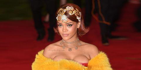 Yellow, Fur clothing, Hair accessory, Fashion accessory, Headpiece, Headgear, Eyelash, Costume, Animal product, Fur,