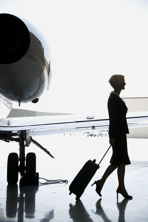 Flight attendant in high heels leaving plane