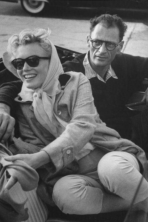 Shortly after their marriage, American actress Marilyn Monroe (1926 - 1962) and American playwright Arthur Miller (1915 - 2005) sit in a Thunderbird convertible on their way to Connecticut with Monroe's close friend, American photographer Milton Greene (not pictured), New York, New York, early July 1956. (Photo by Paul Schutzer/The LIFE Picture Collection/Getty Images)