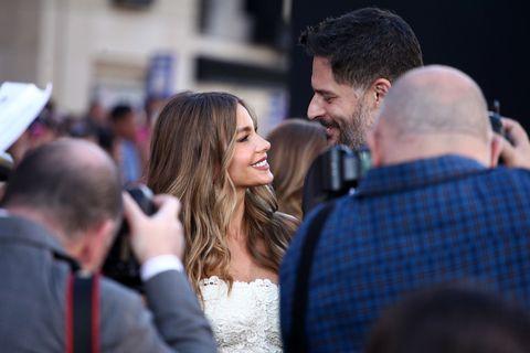 Head, People, Happy, Dress, Interaction, Bridal clothing, Wedding dress, Ceremony, Strapless dress, Beard,