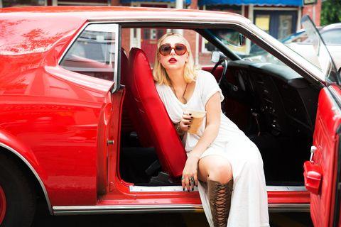 Eyewear, Motor vehicle, Vehicle, Land vehicle, Automotive design, Sunglasses, Red, Vehicle door, Car, Fender,