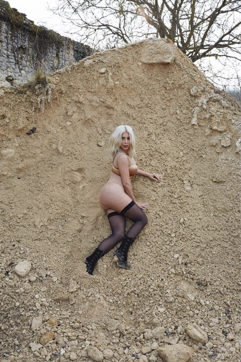 Brown, Human leg, Rock, Knee, Thigh, Bedrock, Blond, High heels, Long hair, Boot,