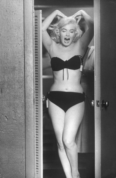<p>Trying on wardrobe options in August 1960.</p>