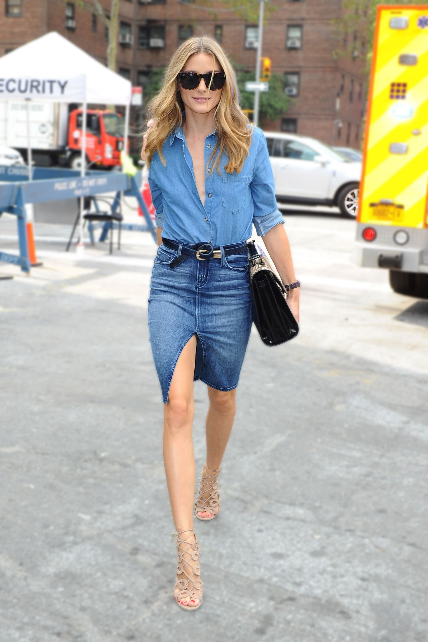 <p>Unbuttoned chambray shirt? Check. Denim skirt with center front split? Check. Fashionably knotted belt? Check. Nude sandals? Check. Probably the sexiest double denim look we've <em>ever</em> seen? Check.</p>