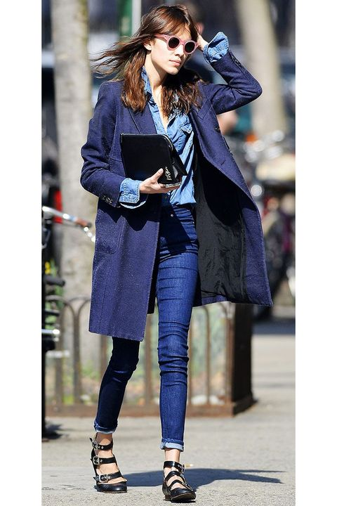 <p>The key to layering denim is to make sure you're pairing different shades. A light-wash denim blouse tucked into dark skinny jeans and worn under a navy topcoat is the epitome of casual-cute, thanks to the ridiculously cool tri-buckle flats. </p>