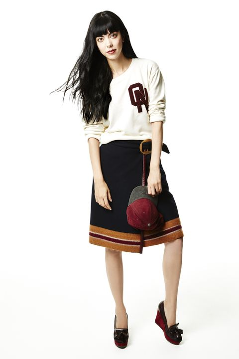 "<p>When you've outgrown the plaid miniskirt uniform, graduate to a knee-length wrap alternative with a striped hem. Pair it with high-heeled wedge tassel loafers, and then make it un-fussy (and totally not Britney-Spears-circa-1999) with sporty details: a baseball cap and a letterman sweatshirt with scrunched-up sleeves. </p><p><em>Old Navy Varsity Sweatshirt, $22, <a href=""https://ad.doubleclick.net/ddm/clk/294200250;121252581;m"" target=""_blank"">oldnavy.com</a>; Similar Tommy Hilfiger Skirt, $613, <a href=""http://www.luisaviaroma.com/index.aspx?#ItemSrv.ashx%7cSeasonId=62I&CollectionId=4SY&ItemId=16&VendorColorId=MzIz0&SeasonMemoCode=actual&GenderMemoCode=women&CategoryId=&SubLineMemoCode="" target=""_blank"">luisaviaroma.com</a>; Old Navy Colorblocked Baseball Cap,<em> $14.94, <a href=""https://ad.doubleclick.net/ddm/clk/294200249;121252583;w"" target=""_blank"">oldnavy.com</a>; Longchamp Pénélope Moccasins, $540, <a href=""http://us.longchamp.com/shoes/penelope/moccasins-8383sdb?sku=33957"" target=""_blank"">longchamp.com</a></em></em></p>"