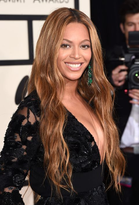 <p>Should you want to buck the cropped trend, grow out your locks, part your hair at the center, and add loose, billowy waves à la Bey.</p>
