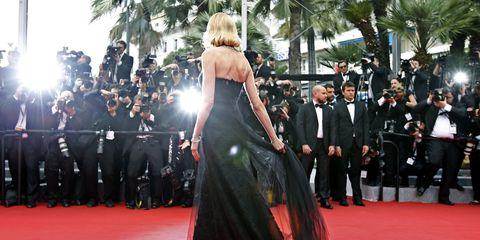 Event, Flooring, Trousers, Dress, Carpet, Outerwear, Coat, Premiere, Suit, Formal wear,