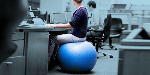 Human body, Swiss ball, Computer keyboard, Office equipment, Sitting, Computer monitor, Desk, Computer desk, Knee, Office chair,