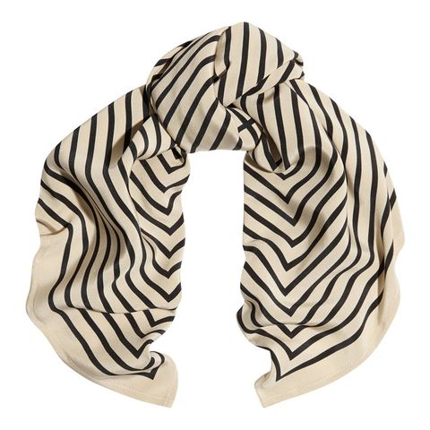"<p>Slightly retro, yet totally of-the-moment, it'll add a certain <em>je nais se quoi</em> to your tried-and-true T-shirt and jeans look.</p><p>Totême Striped Silk-Faille Scarf, $200; <a href=""http://www.net-a-porter.com/product/575348/Toteme/striped-silk-faille-scarf"" target=""_blank"">net-a-porter.com</a>.</p>"
